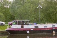 water;river;Fossdyke;Lincoln;lincolnshire;UK;navigation;navigable;boat;house-boat;moored;moorings;flower;wild-flower;spring;Red-Campion;river-bank;vegetation;boat;house-boat;lifestyle;carbon;low-carbon;efficient;green;environment;location;energy;power;electricity;renwable-energy;wind;wind-power;wind-turbine;self-sufficient;windmill