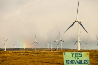 Scotland;Lanarkshire;climate-change;global-warming;energy;power;renewable-energy;clean-energy;carbon-neutral;wind-power;wind-farm;wind-turbine;carbon-footprint;moorland;sky;blue;cloud;Whitelee;Whitelee-windfarm;Eaglesham;Eaglesham-moor;sustainable;sustainability;large;MW;megawatt;output;energy-needs;energy-production;electricity-production;rotor;turbine;nacelle;Scottish-Power;energy-company;investment;green-investment;light;sun;shade;grey;rain;shower;refraction;rainbow;raining;colour-spectrum;spectrum;banner;placard;sign;protest;yes;renewables;renewable-energy