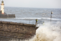 Whitehaven;Cumbria;UK;weather;extreme-weather;harbour;wall;battering;wave;crashing;breaking;storm;wind;windy;low-pressure;weather-bomb;West-Coast;Irish-Sea;stormy;stormy-weather;high-tide;wave-height;overpowering;power;powerful;wave-power;lighthouse;house;building;man;stupid;danger;dangerous;exposed;foolhardy