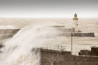 Whitehaven;Cumbria;UK;weather;extreme-weather;harbour;wall;battering;wave;crashing;breaking;storm;wind;windy;low-pressure;weather-bomb;West-Coast;Irish-Sea;stormy;stormy-weather;high-tide;wave-height;overpowering;power;powerful;wave-power;lighthouse;house;building;man;danger;exposed;foolhardy
