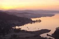 Ambleside;Lake-District;Cumbria;UK;national-park;water;lake;Windermere;Lake-Windermere;dawn;sunrise;morning;glow;pink;red;sky;cloud;tree;woodland;promontary;lake-shore;shoreline;Waterhead;Todd-Crag;Loughrigg;winter;misty;magical;ethereal;calm;tranquil;landscape;boat;yacht;sailing-boat;frost;frosty;cold;winter;freezing