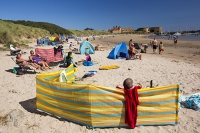 coast;seaside;summer;holiday;sand;sandy;white-sand;sandy-beach;North-Sea;Northumberland;UK;beach;tidal;sea;shelter;rainbow;colourful;wind-break;family;crowd;crowded;summer-holiday;tanning;suntan;relax;beach-holiday;Beadnell;sunbathing