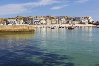 St-Ives;harbour;high-tide;Cornwall;UK;coast;sea;shallow;summer;holiday;town;boat;craft;lifeboat;RNLI;sky;blue;sun;sunny;bright;gull;bird;seagull;house;housing;shop;seafront;promenade;beach;sand;aquamarine