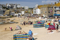St-Ives;harbour;Cornwall;UK;coast;sea;shallow;summer;holiday;town;boat;craft;sky;blue;sun;sunny;bright;house;housing;shop;seafront;promenade;colourful;red;yellow;beach;sand;crowd;relaxing;summer-holiday;tourist;tourism;beach-holiday;wind-break;shelter;crowds;people;family