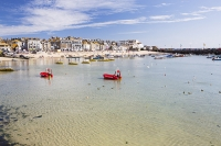 St-Ives;harbour;high-tide;Cornwall;UK;coast;sea;shallow;summer;holiday;town;boat;craft;sky;blue;sun;sunny;bright;gull;bird;seagull;house;housing;shop;seafront;promenade;colourful;red;yellow;rib;inflateable;Herring-Gull;beach;sand