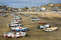 St-Ives;harbour;low-tide;Cornwall;UK;coast;sea;shallow;summer;holiday;town;boat;craft;sky;blue;sun;sunny;bright;house;housing;shop;seafront;promenade;colourful;beach;sand;fishing-boat;fishing-fleet;small-boat