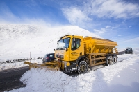 hill;mountain;Lake-District;Cumbria;UK;weather;winter;cold;snow;snow-storm;white;National-Park;meteorology;Kirkstone;Kirkstone-Pass;road;car;motoring;driving;driving-conditions;road;motorist;council-worker;workman;yellow;snow-plough;salting;gritting;gritter