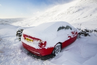 hill;mountain;Lake-District;Cumbria;UK;weather;winter;cold;snow;snow-storm;white;National-Park;meteorology;Kirkstone;Kirkstone-Pass;road;car;motoring;driving;driving-conditions;road;motorist;red;ice;icy;slippy;BMW