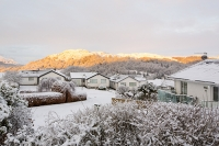 sunrise;dawn;light;glow;snow;winter;weather;hill;mountain;Lake-District;Cumbria;UK;snowfall;white;cold;freezing;snow-pack;slope;pink;cloud;house;detatched;location;view;vista;expensive;suberbs;Ambleside;Loughrigg;Todd-Crag