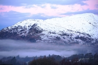 sunrise;dawn;light;glow;snow;winter;weather;hill;mountain;Lake-District;Cumbria;UK;snowfall;white;cold;freezing;snow-pack;slope;pink;cloud;view;vista;expensive;Ambleside;glow;Fairfield