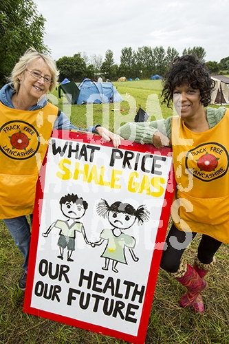 Protestors with a protest banner against fracking at a farm site at Little Plumpton near Blackpool, Lancashire, UK, where the council for the first time in the UK, has granted planning permission for commercial fracking fro shale gas, by Cuadrilla.