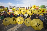 fracking;shale-gas;Blackpool;Lancashire;UK;protest;fossil-fuel;climate-change;global-warming;banner;placard;concern;environment;environmentalist;yellow;colourful;gas;energy;energy-policy;planning;planning-application;planning-appeal;Cuadrilla;David-and-Goliath;battle;localism;democracy;person;man;woman;concerned;green;umbrella