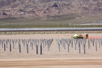 USA;US;America;Nevada;desert;electricity;generating;renewable;renewable-energy;solar;solar-power;solar-panel;PV;photo-voltic;South;aspect;south-facing;carbon-neutral;climate-change;global-warming;sign;Copper-Mountain;copper-mountain-solar;investment;clean-energy;technology;construction;green;green-energy;construction-work;engineering;flat;valley-floor;man;male;construction-worker;worker;PPE;hard-hat;helmet;orange;high-vis;heat;hot;sun;sunlight;sunstroke;shelter;protection;footings