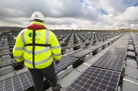 Hyde;Manchester;UK;United-Utilities;reservoir;water;water-supply;drinking-water;solar;solar-power;solar-farm;floating;floating-solar;solar-panel;PV;photo-voltaic;electricity;green;clean;carbon-neutral;climate-change;global-warming;innovative;novel;floats;renewable-energy;man;male;workman;PPE;health-and-safety;high-vis;green-jobs