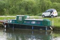 water;river;Fossdyke;Lincoln;lincolnshire;UK;navigation;navigable;boat;house-boat;moored;moorings;river-bank;vegetation;lifestyle;carbon;low-carbon;efficient;green;environment;location;car;Smart-car;small;small-car;green-car
