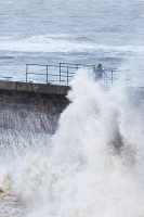 Whitehaven;Cumbria;UK;weather;extreme-weather;harbour;wall;battering;wave;crashing;breaking;storm;wind;windy;low-pressure;weather-bomb;West-Coast;Irish-Sea;stormy;stormy-weather;high-tide;wave-height;overpowering;power;powerful;wave-power;man;stupid;danger;dangerous;exposed;foolhardy
