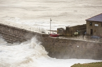 Whitehaven;Cumbria;UK;weather;extreme-weather;harbour;wall;battering;wave;crashing;breaking;storm;wind;windy;low-pressure;weather-bomb;West-Coast;Irish-Sea;stormy;stormy-weather;high-tide;wave-height;overpowering;power;powerful;wave-power;house;building;car