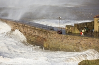 Whitehaven;Cumbria;UK;weather;extreme-weather;harbour;wall;battering;wave;crashing;breaking;storm;wind;windy;low-pressure;weather-bomb;West-Coast;Irish-Sea;stormy;stormy-weather;high-tide;wave-height;overpowering;power;powerful;wave-power;house;building;man;danger;dangerous;exposed;fool-hardy;stupid