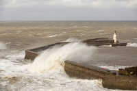 Whitehaven;Cumbria;UK;weather;extreme-weather;harbour;wall;battering;wave;crashing;breaking;storm;wind;windy;low-pressure;weather-bomb;West-Coast;Irish-Sea;stormy;stormy-weather;high-tide;wave-height;overpowering;power;powerful;wave-power;lighthouse;house;building;spray;salt-spray;man;exposed;danger;dangerous;stupid;fool-hardy;reckless