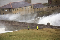 Whitehaven;Cumbria;UK;weather;extreme-weather;harbour;wall;battering;wave;crashing;breaking;storm;wind;windy;low-pressure;weather-bomb;West-Coast;Irish-Sea;stormy;stormy-weather;high-tide;wave-height;overpowering;power;powerful;wave-power;house;building;man;exposed;danger;dangerous
