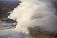 Whitehaven;Cumbria;UK;weather;extreme-weather;harbour;wall;battering;wave;crashing;breaking;storm;wind;windy;low-pressure;weather-bomb;West-Coast;Irish-Sea;stormy;stormy-weather;high-tide;wave-height;overpowering;power;powerful;wave-power;lighthouse;house;building;spray;salt-spray;rainbow;bird;gull;seagull;flight;fly