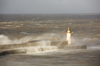 Whitehaven;Cumbria;UK;weather;extreme-weather;harbour;wall;battering;wave;crashing;breaking;storm;wind;windy;low-pressure;weather-bomb;West-Coast;Irish-Sea;stormy;stormy-weather;high-tide;wave-height;overpowering;power;powerful;wave-power;lighthouse;house;building;spray;salt-spray;renewable-energy;robin-rigg;wind-turbine;wind-farm;offshore-wind