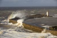 Whitehaven;Cumbria;UK;weather;extreme-weather;harbour;wall;battering;wave;crashing;breaking;storm;wind;windy;low-pressure;weather-bomb;West-Coast;Irish-Sea;stormy;stormy-weather;high-tide;wave-height;overpowering;power;powerful;wave-power;lighthouse;house;building;spray;salt-spray;rainbow