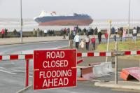 sea;irish-sea;coast;cloud;sky;wave;Morecambe-Bay;Lancashire;climate-change;global-warming;Cleveleys;Blackpool;beach;beached;run-aground;ship;vessel;shipwreck;weather;storm;extreme-weather;wrecked;abandoned;Riverdance;ferry;boat;danger;emergency;evacuation;cargo;list;listing;leaning;hull;steel;battered;storm-wave;damaged;salvage;rescue;lorry;haulage;HGV;police;cordon;security-zone;road-closed;flooding
