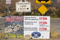 USA;US;America;California;desert;Tehachapi-Pass;brown;drought;dessicated;dried-up;climate-change;global-warming;tree;branch;dead;dying;killed;hill;farmland;parched;Kern-county;Fire-Department;wildfire;poster;notice;survive;defensible-space;law;clearing