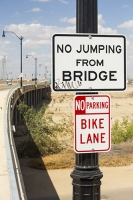 USA;US;America;California;brown;drought;dessicated;dried-up;climate-change;global-warming;parched;Kern-County;Kern-River;river-bed;burnt;Bakersfield;sand;sandy;concrete;bridge;crossing;road;highway;support;column;sign;danger;no-jumping;jump