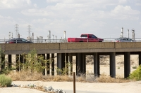 USA;US;America;California;brown;drought;dessicated;dried-up;climate-change;global-warming;parched;Kern-County;Kern-River;river-bed;burnt;Bakersfield;sand;sandy;concrete;bridge;crossing;road;highway;support;column