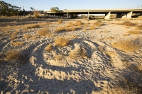 USA;US;America;California;brown;drought;dessicated;dried-up;climate-change;global-warming;parched;Kern-County;Kern-River;river-bed;burnt;Bakersfield;sand;sandy;concrete;bridge;crossing;road;highway;support;column;spiral-circle;pattern;shape;art