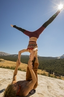 USA;US;America;California;tourist-attraction;light;sunlight;Yosemite-National-Park;Autumn;Fall;tree;mountain;forest;granite;rock;batholith;geology;weathering;erosion;igneous;dome;man;woman;male;female;young;twentys;performer;performance;art;skill;balance;strength;agility;lift;lifting;circus-act;athlete;athletic;muscles;muscle-strength;grace;poise;hold;trust;trusting;backdrop;arms;legs;body;feet;head-stand;hand-stand