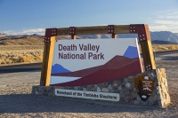 California;USA;America;Death-Valley;desert;drought;hot;dry;low;heat;mountain;mountain-range;light;warm;glow;dawn;sunrise;Great-Western-Divide;road;highway;Death-Valley;national-park;sign;exit;leaving;thankyou;thanks;visiting;tourist-attraction;tourism;Timbisha-Shoshone;tribe;first-nation;american-Indian