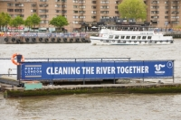 London;UK;city;inner-city;building;river;Thames;River-Thames;barge;transport;river-transport;floating;rubbish;wharf;dock;jetty;moored;mooring;infrastructure;crane;bridge;waste-management;waste;trash;garbage;refuse;clean;cleaning;litter-trap;trap;plastic
