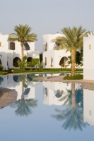 Egypt;Sinai;desert;sinai-desert;Dahab;Red-Sea;resort;coast;holiday;vacation;sea;building;architecture;arabic;arab;muslim;hotel;Hilton;Dahab;luxury;accomodation;white;heat;hot;dry;drought;tree;pool;swimming-pool;water;water-use;suite;reflection;palm-tree;calm