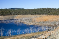 Australia;Snowy-mountains;New-South-Wales;climate-change;global-warming;drought;dry;dried-up;water-supply;water-levels;lake;reservoir;water-shortage;revealed;shore;lake-shore;Adaminaby;Lake-Eucumbene;dam-dam-wall;sky;blue