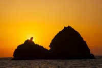 Lemnos;Greece;Limnos;Mirina;Myrina;Aegean;Meditteranean;sun;sunlight;warm;coast;sunset;evening;dusk;silhouette;tranquil;peaceful;calm;light;glow;glowing;rock;island;stack;eroded;erosion;geology;triangle;steep;rocky;shape;sharp;pointed
