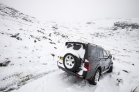 Lake-District;UK;snow;winter;cold;weather;Little-Langdale;snowing;road;road-closed;closed;ice;gradient;steep;Wrynose;Wrynose-Pass;car;vehicle;four-wheel-drive;Chelsea-Tractor;abandoned;stuck;blocking;stupid;motorist;fool;foolish;thoughtless;boulder;rock;snowed-in;wheel;tyre