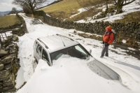 Ambleside;Lake-District;Cumbria;UK;winter;weather;extreme-weather;white;snow;cold;snowpack;snow-drift;drifting-snow;National-Park;snow-storm;blizzard;prevailing-wind;windy;wind;freezing;road;struggle;kirkstone-pass;road-closed;mountain-pass;shape;pattern;form;sculpted;scour;scoured;wind-scour;wall;wall;snow-drift;blockage;snowdrift;blocked;closed;car;abandoned;snowed-in;snowed-up;four-by-four;four-wheel-drive;chelsea-tractor;stuck;man;male;walker