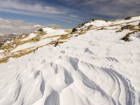 Lake-District;Cumbria;UK;winter;weather;extreme-weather;white;snow;cold;snowpack;snow-drift;drifting-snow;National-Park;prevailing-wind;windy;wind;freezing;Wrynose-pass;shape;pattern;form;sculpted;scour;scoured;wind-scour;snow-drift;shape;pattern;form;sastrugi;shaped;art