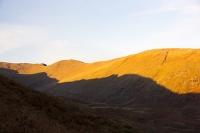 Autumn-colours;Lake-District;Cumbria;UK;view;vista;hill;season;Fall;Fall-colours;Fairfield;ridge;Rydal;Rydal-Valley-light;glow;glowing;sunset;light;bracken;brown