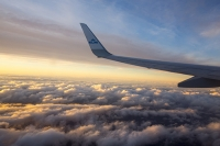 window;airpane;jat-plane;travel;cloud;aerial;sunset;glow;dusk;above-the-clouds;sky;water-vapour;West;wing;plane-wing;KLM;airline;Dutch