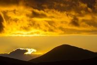 Harris;Isle-of-Harris;Outer-Hebrides;hebrides;Scotland;UK;Leverburgh;light;warm;glow;sunlight;dusk;sunset;hill;mountain;peak;sky;Greabhal;Diver;bird;flight;flying