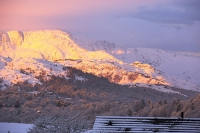 sunrise;dawn;light;glow;snow;winter;weather;hill;mountain;Lake-District;Cumbria;UK;snowfall;white;cold;freezing;snow-pack;slope;pink;cloud;house;detatched;location;view;vista;expensive;suberbs;Ambleside;field;sheep;hardy