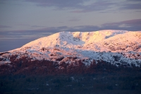sunrise;dawn;light;glow;snow;winter;weather;hill;mountain;Lake-District;Cumbria;UK;snowfall;white;cold;freezing;snow-pack;slope;pink;cloud;view;vista;expensive;Ambleside;Coniston-Old-Man;glow