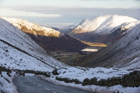 car;descending;Kirkstone-Pass;Ullswater;Lake-District;Cumbria;UK;mountain;hill;mountain-pass;travel;driving;steep;Brothers-Water;winter;snow;driving-conditions;snow;Plaice-Fell;road