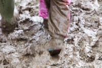 mud;muddy;field;churned-up;quagmire;wet;saturated;weather;rain;soil;trample;trampled;Lowther;Penrith;Cumbria;UK;World-Sheep-Dog-Trials;competition;event;family;child;parent;wellies;wellingtons;wellington-boots;boots;walking;pink;board-walk;struggle;struggling;footwear;pink;girl