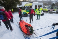 Lake-District;Cumbria;National-Park;UK;hill;winter;cold;snow;snowpack;freezing;weather;mountain;mountain-rescue;rescue;paramedic;air-ambulance;doctor;treatment;casualty;injured;emergency-services;team-work;stretcher;evacuation;high-vis;yellow;Langdale;sled;ambulance