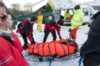 Lake-District;Cumbria;National-Park;UK;hill;winter;cold;snow;snowpack;freezing;weather;mountain;mountain-rescue;rescue;paramedic;air-ambulance;doctor;treatment;casualty;injured;emergency-services;team-work;stretcher;evacuation;high-vis;yellow;Langdale;Air-Ambulance;helicopter;aircrew